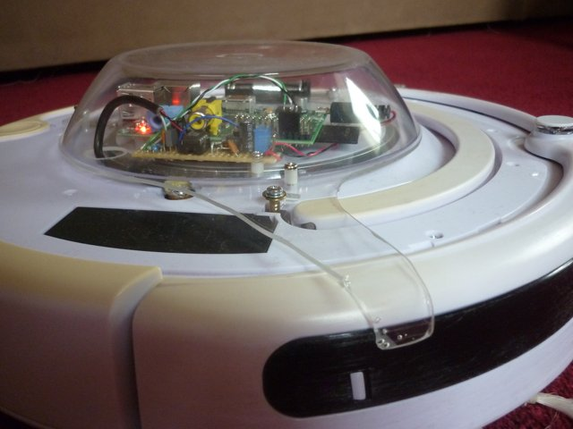 A raspberry pi on a Roomba - side view